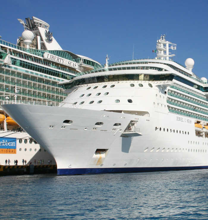 Two royal caribbean cruise ships docked together