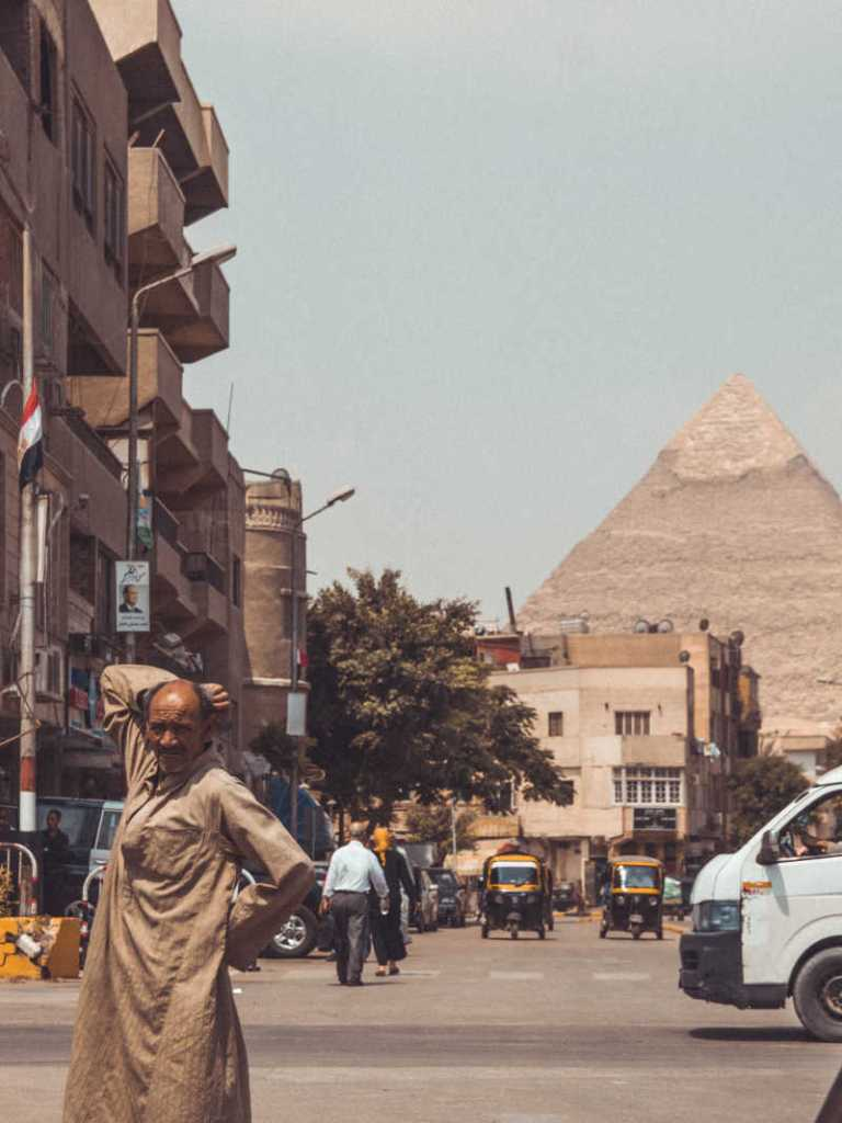 cairo egypt street with pryamid in background (1)