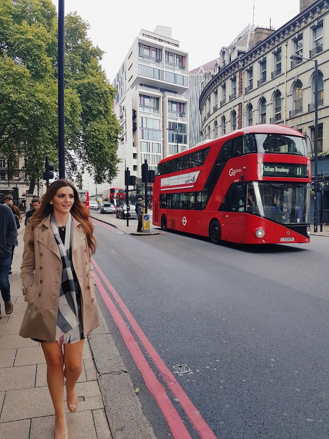traveler in front of grosvenor-hotel-london