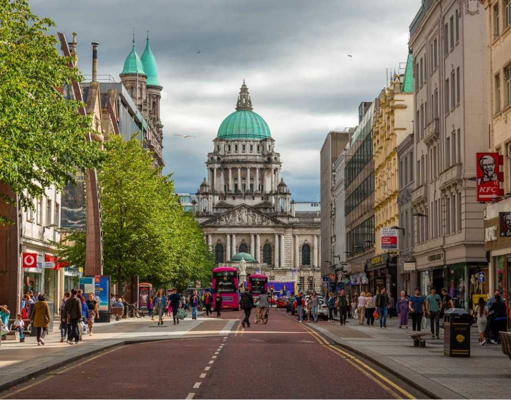 Belfast Northen Ireland city hall with tourists shopping