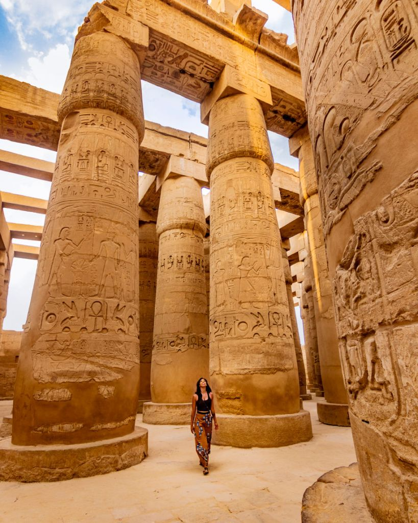 Traveler wandering through the ancient Karnak Temple in Egypt