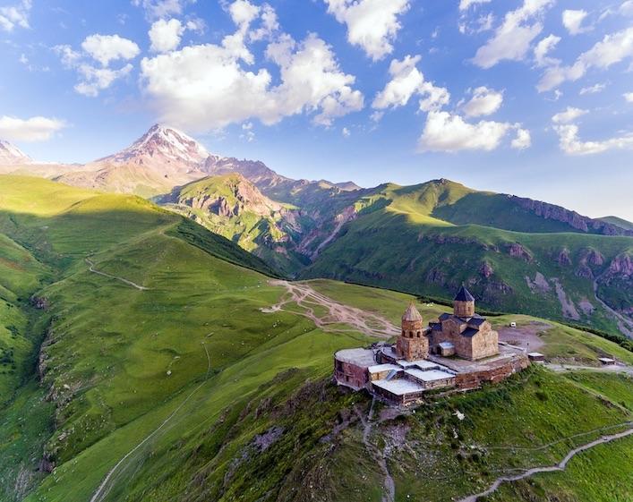 Holy Trinity Church Near Village Of Gergeti In Georgia