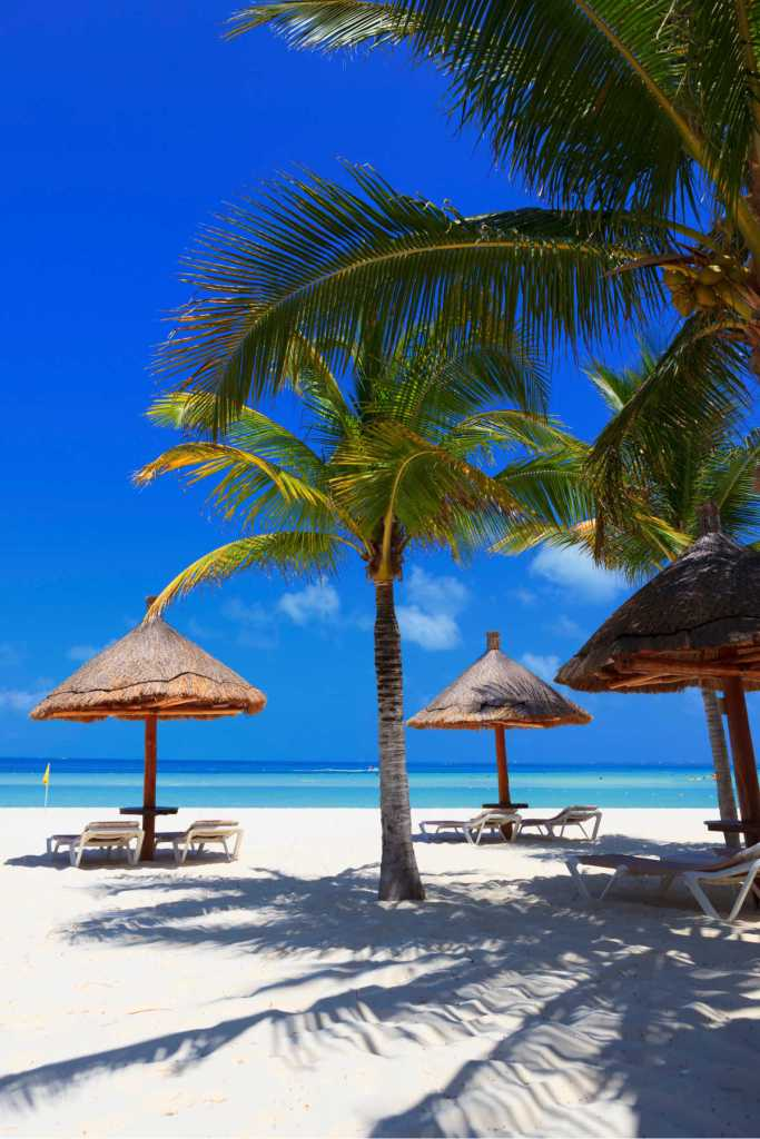Beach huts on white sand beach in Cancun