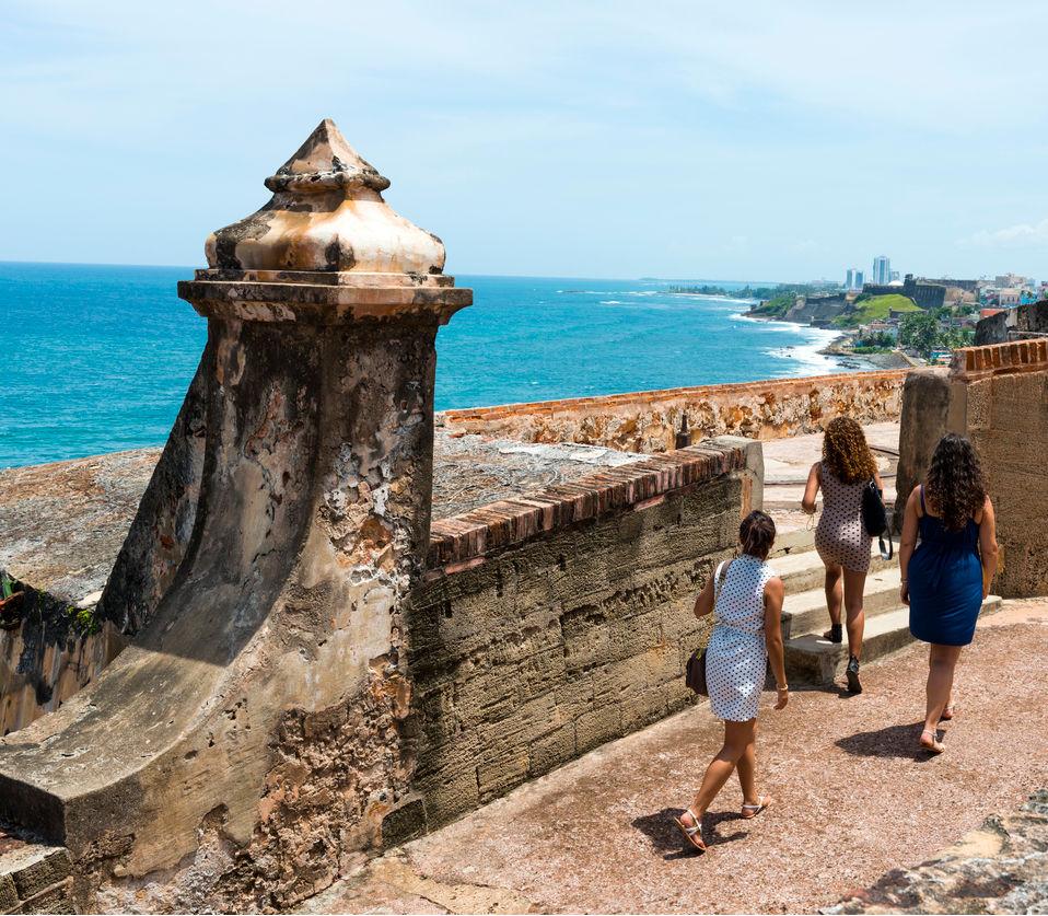 Three women women from New York, on vacation in Puerto Rico, visit Castillo San Felipe del Morro, a 16th-century Spanish fort in San Juan