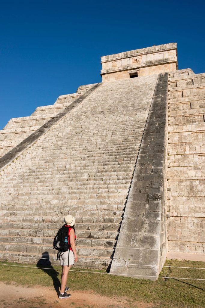 Woman admiring the Mayan Kukulkan Pyramid (El Castillo) in Chichen Itza in the Yucatan Peninsula, Mexico