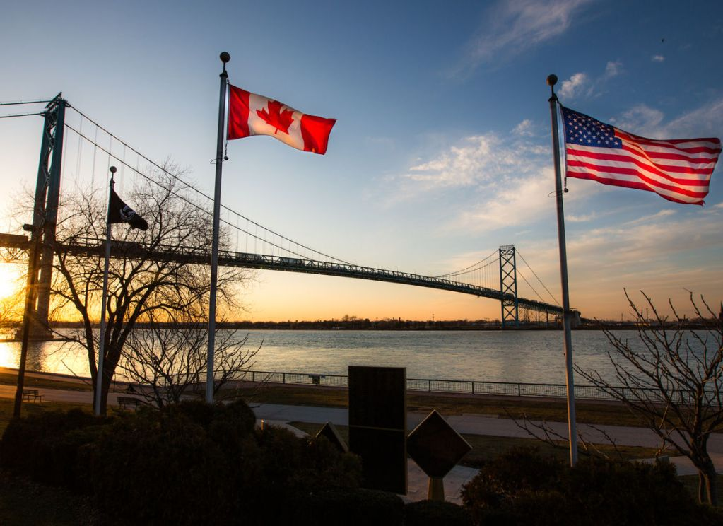 canada and usa border flags