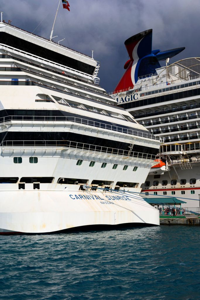 Carnival Magic and Sunrise docked in port