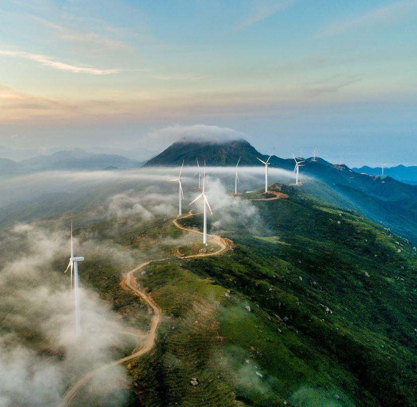Wind Turbines On Cloudy Hillside