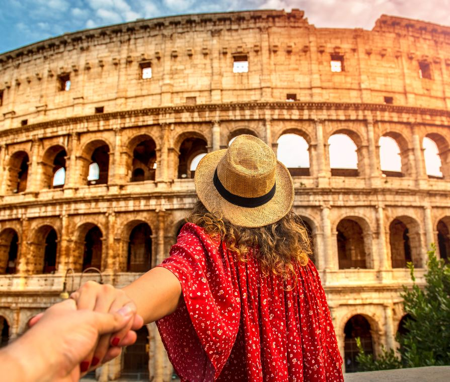 woman looking at colosseum