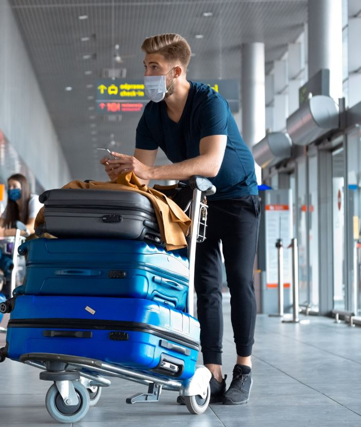 man travel airport mask