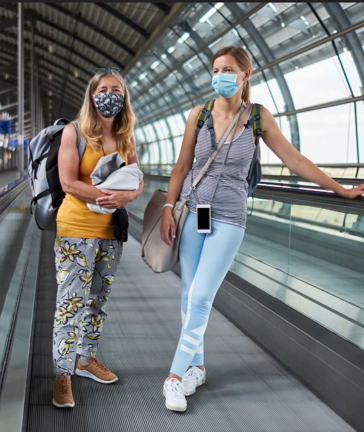 women returning home to canada from travel wearing masks