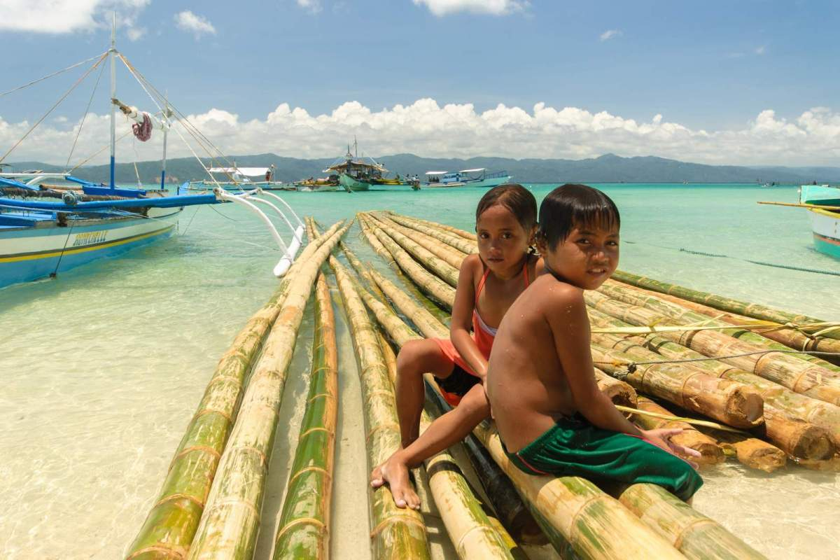Children playing in the waters of Sabang, Cagbalete Island