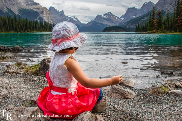 On the shores of the Maligne Lake, overlooking the Spirit Island, my little daughter sat quietly. Travel Realizations