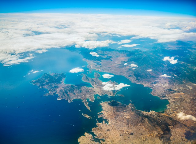 Aerial view on Greek coast with Athens, Salami island, airport, harbor and numerous ships,