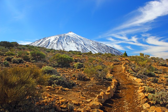 Boulder lined hiking trail at volcano Mount Teide on Canary Islands