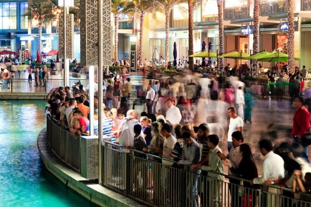 Busy evening at Dubai downtown, Dubai Mall, Dubai fountain. People waiting for fountain to play its show.