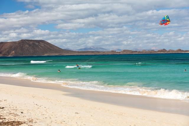 Corralejo, Feurteventura, Spain - September 15, 2015: Kite surfer in the beaches of Fuerteventura, Spain