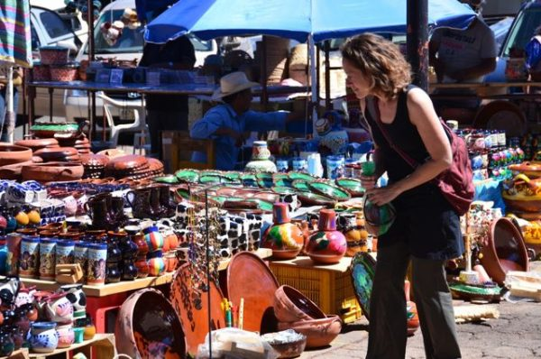 A market at Tzintzuntzán, Mexico and Kenda's wearing Athleta activewear that saves money and space packing