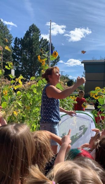 Amanda Egertson releasing monarch butterfly