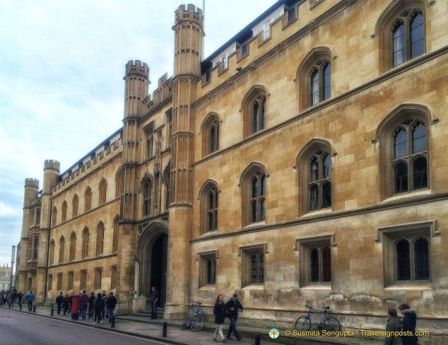Walking along Trumpington Street in front of Corpus Christi College in Cambridge
