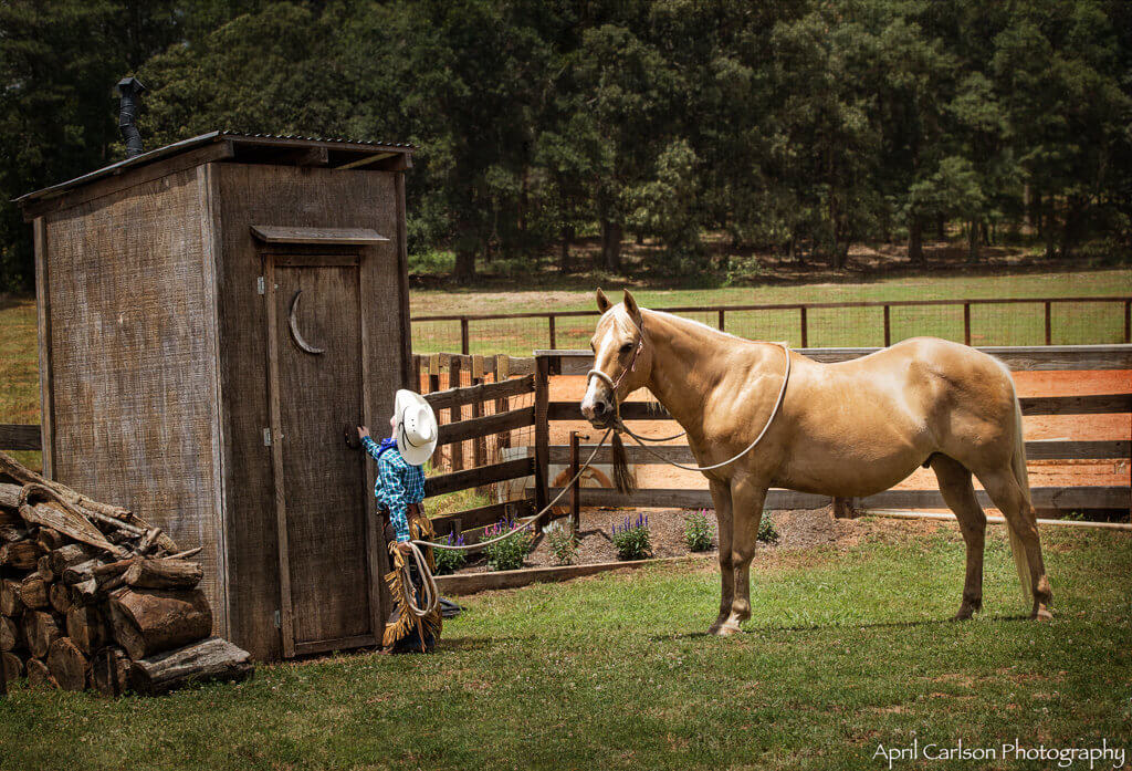 Horse Photography Workshop: Adorable boy and palimino horse wait at an outhouse