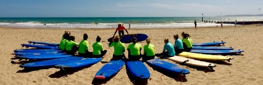 learn to surf in dorset, england