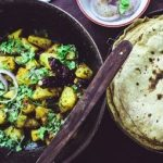 : Baked roti - one of the dishes you must try when traveling to India