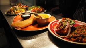 Masala dosa and other dishes served on the table.