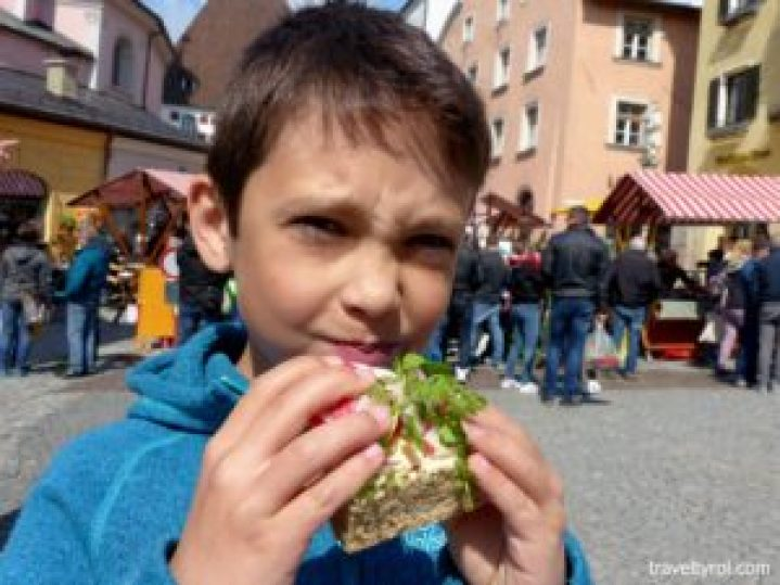 Tyrolean eating radish sandwich.