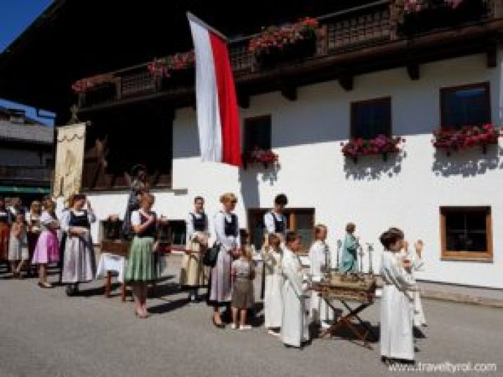 Children and women in Fronleichnam procession in Tulfes.