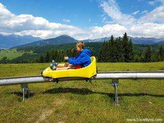 Mieders alpine coaster speeds down mountain.