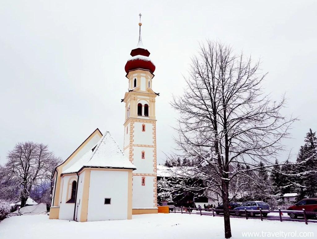 Snow-covered church in Austria in winter.