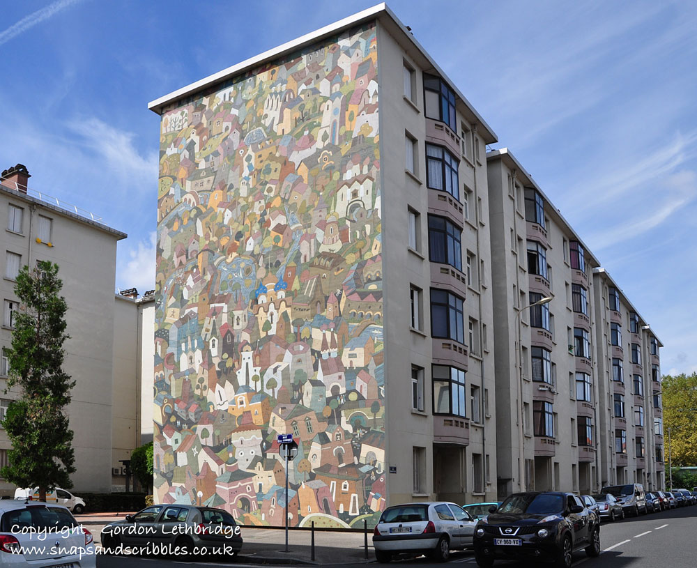 Murals on the end of apartment blocks in the Etats Unis district of Lyon