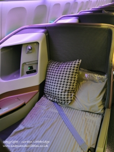 Business Class seat made up as a bed