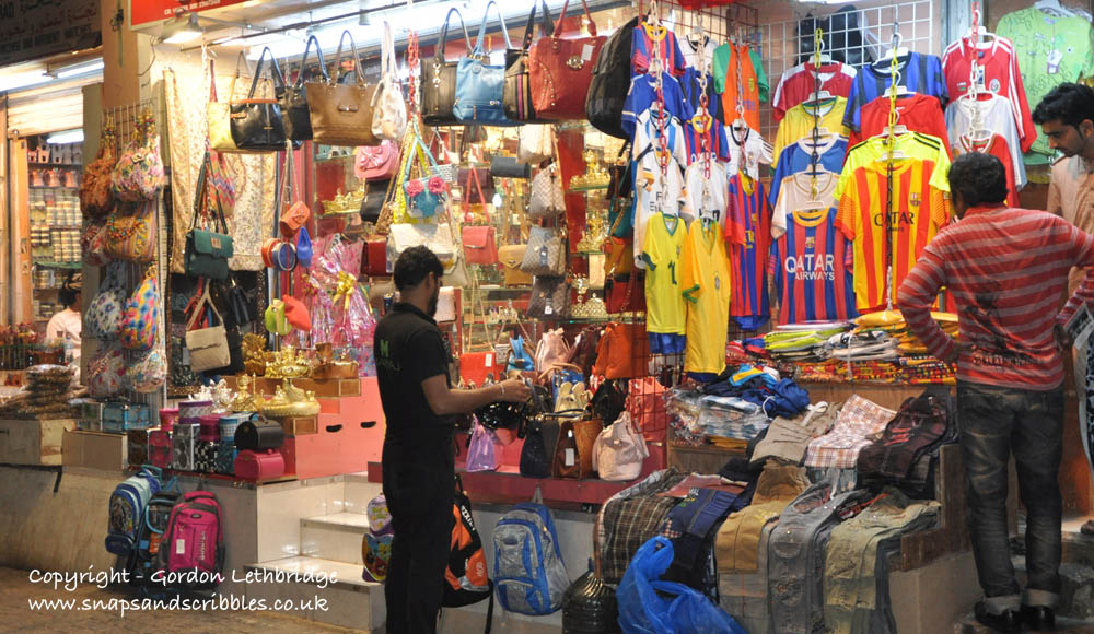 Football shirts and fashion side-by-side in the Mutrah Souq