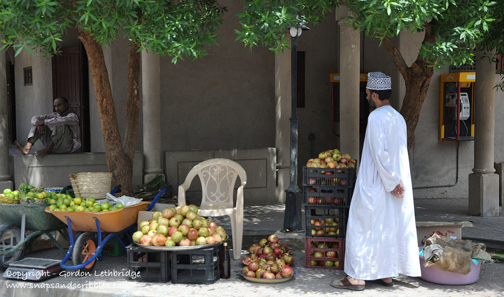 Dates, limes, and pomegranates in the Fruit Souq