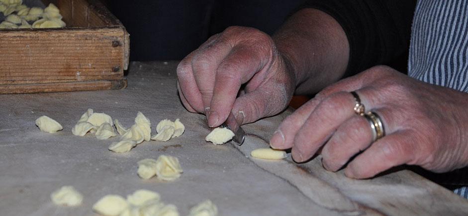 Carmella's expert hands preparing orrechietta