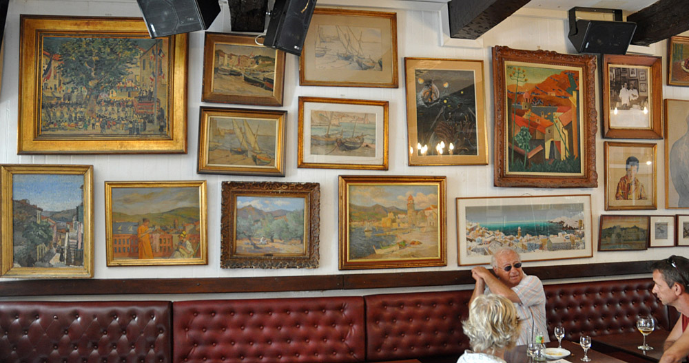 Original art on the walls of the Cafe des Templiers