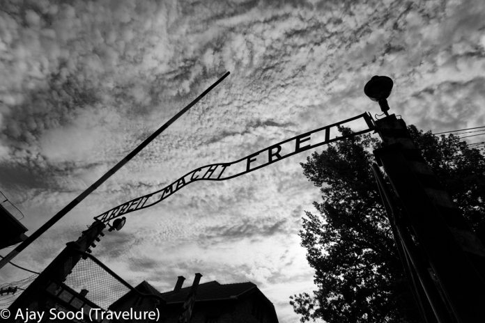 Haunting Photographs of Auschwitz Memorial Camp Entry Gate Work Means Freedom in German - WW-II Holocaust
