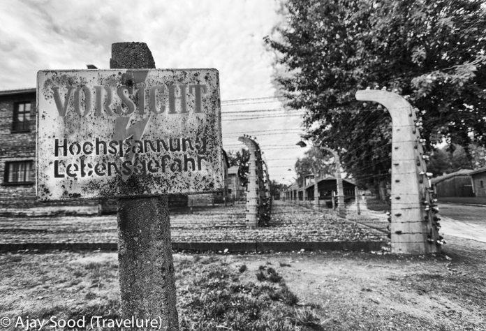 Haunting Photographs of Auschwitz Memorial Camp German Warning Sign High Voltage Warning - WW-II Holocaust