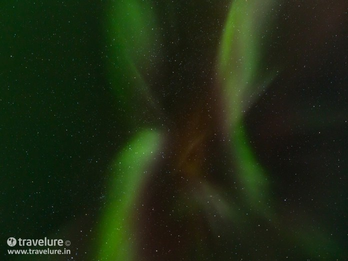 Northern Lights high up in the sky - Instagram Roundup - Iconic Iceland