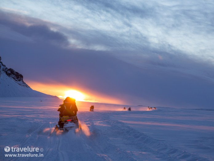 Snowmobiles at Langjökull Glacier in low sun - Instagram Roundup - Iconic Iceland