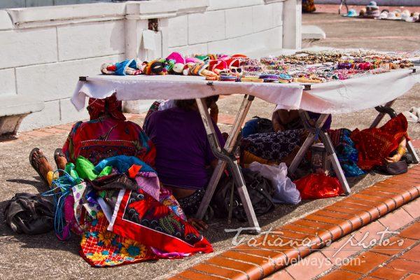 Kuna vendors hiding from the sun in Casco Viejo, Panama
