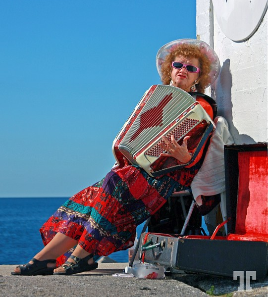 Accordion Player Lady at Peggy's Cove Lighthouse, Nova Scotia