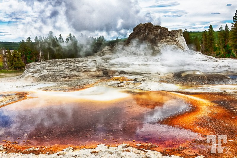 Fuming basin around the castle geyser with orange colors