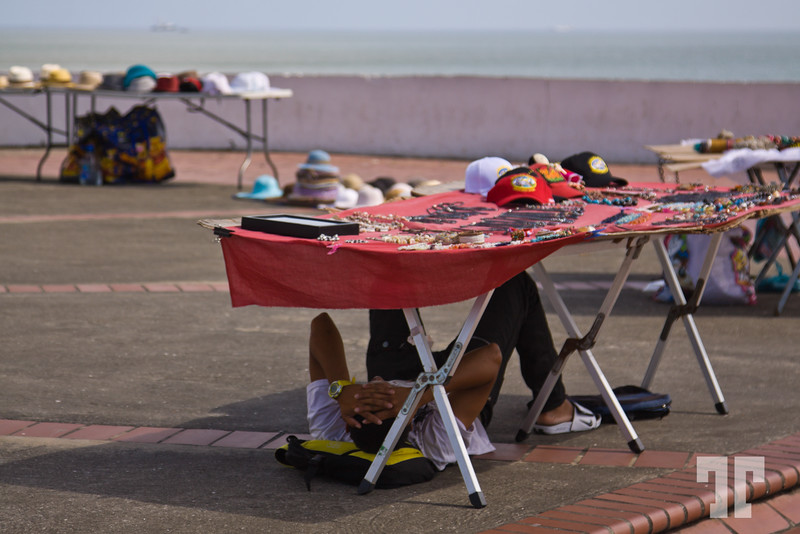 Kuna vendor hiding from the sun in Casco Viejo Panama, while taking the siesta.