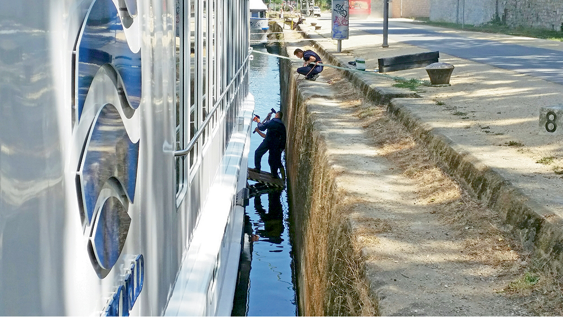 Uniworld crew members prepare vessels before the river cruising season gets underway.
