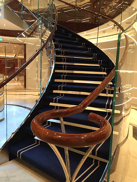 This staircase bannister is an example of the more rounded, curvaceous design of the Seabourn Encore. Photo Credit: Tom Stieghorst