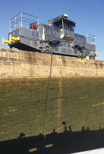 """An electric locomotive """"mule"""" attached to the Star Pride to pull it through one of the locks in the canal and minimize the chances for accidents. Photo Credit: Tom Stieghorst"""
