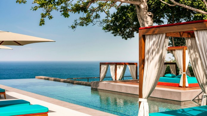 Glassy infinity pools extend gracefully over cliffs at the One&Only Mandarina.